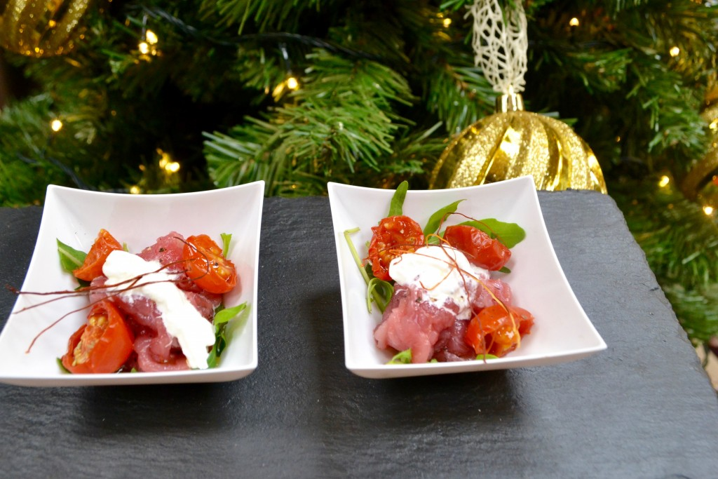 Carpaccio di manzo con stracciatella e pomodori confit