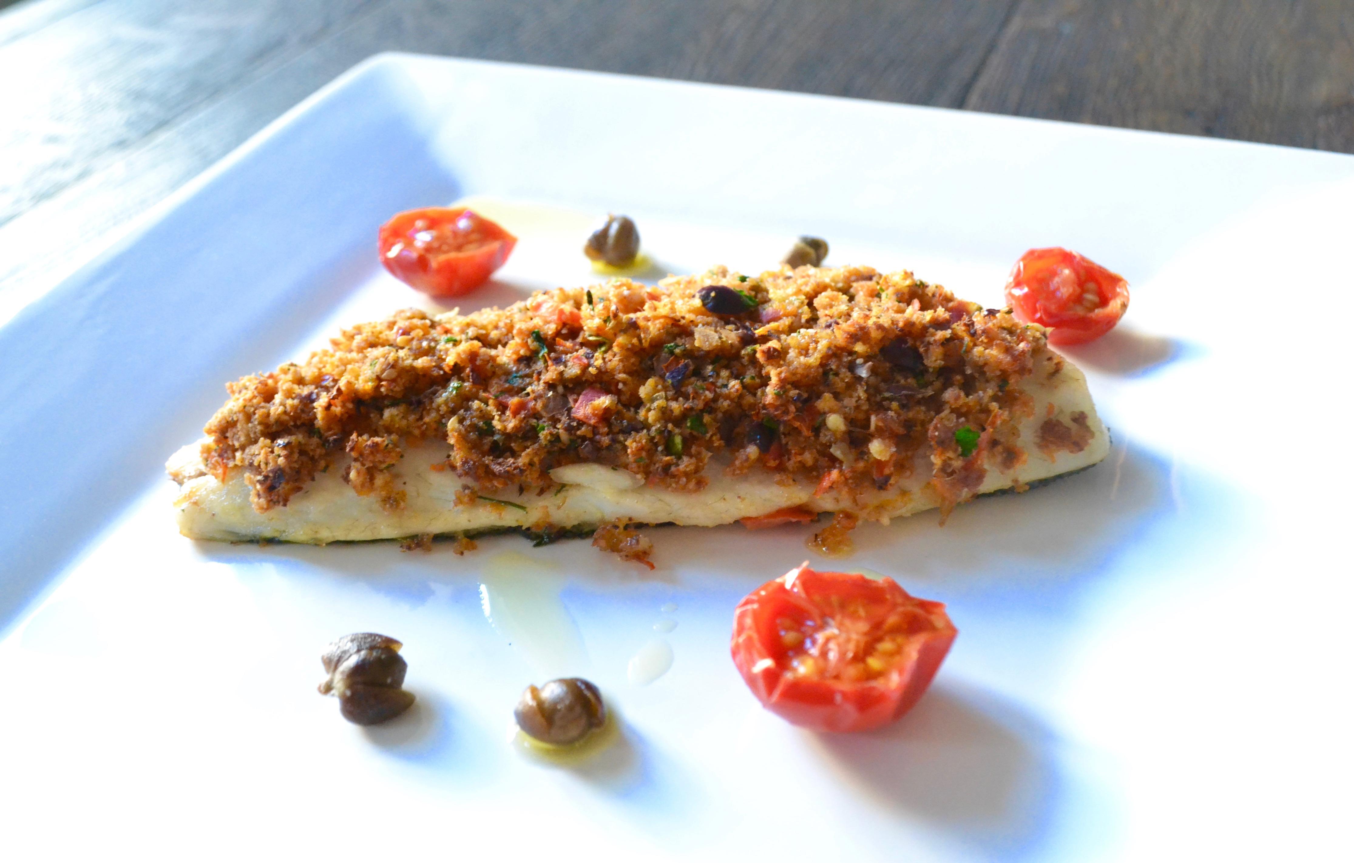 Spigola gratinata con olive taggiasche e pomodorini